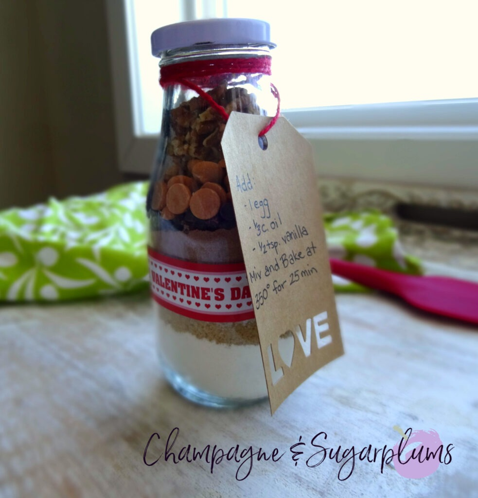 Completed brownies in a bottle with an recipe tag by Champagne and Sugarplums
