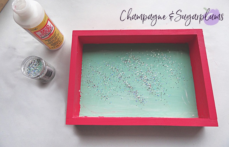 Adding glitter to the inside of a wood box painted in mint by Champagne and Sugarplums