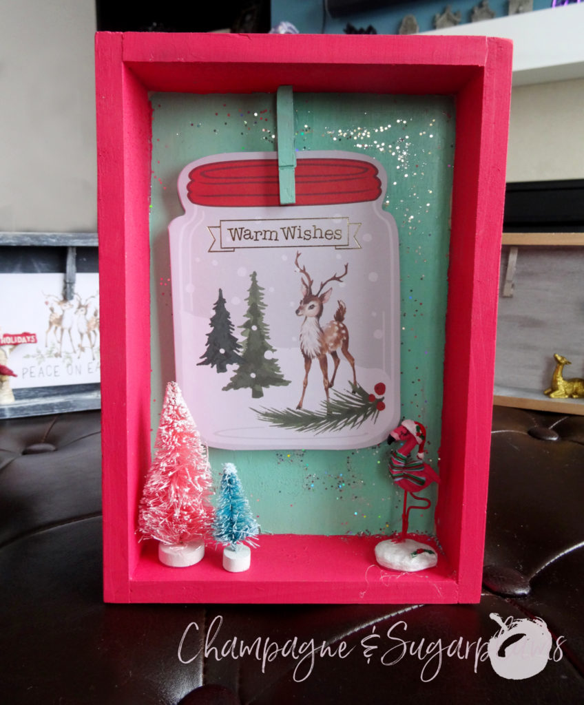 Completed Christmas card holders on a bench focused on the colour pop box by Champagne and Sugarplums