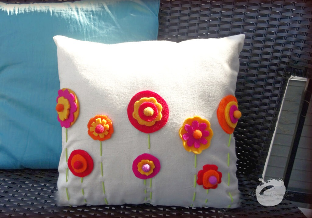 Finished DIY Pillow Cover outside on a bench by Champagne and Sugarplums