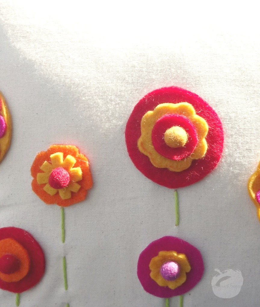 A close up of the finished felt flowers by Champagne and Sugarplums