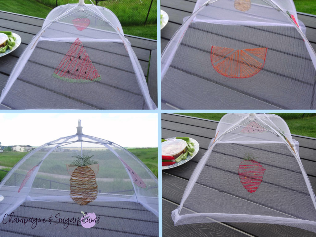 Collage of summer food tent with an embroidered pineapple, orange, watermelon and strawberry by Champagne and Sugarplums