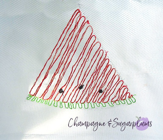 Adding a rind and seeds to an embroidered watermelon by Champagne and Sugarplums