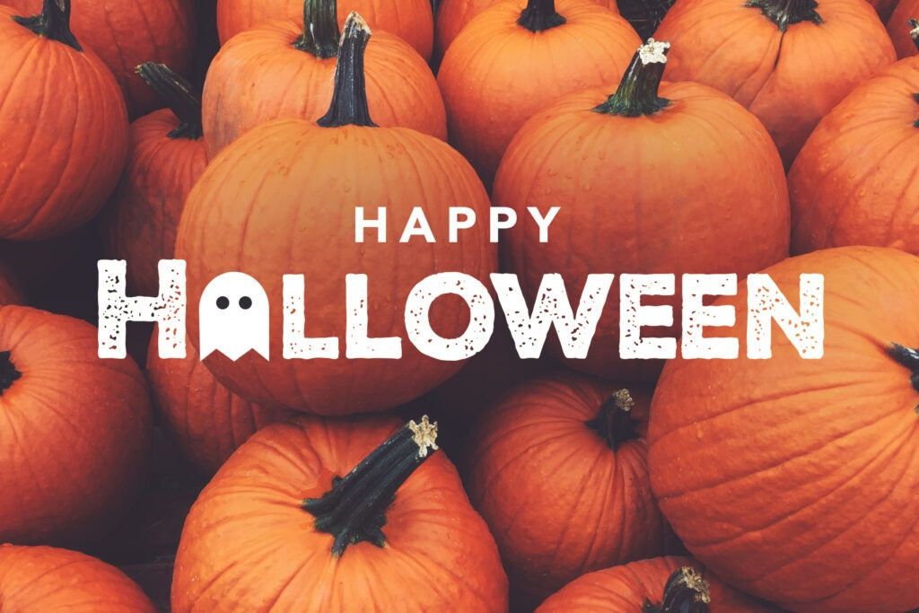 Happy Halloween written on a background of pumpkins