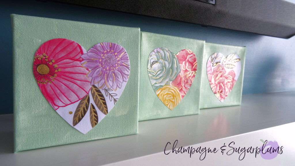 Three completed floral triptych canvases with paper hearts by Champagne and Sugarplums