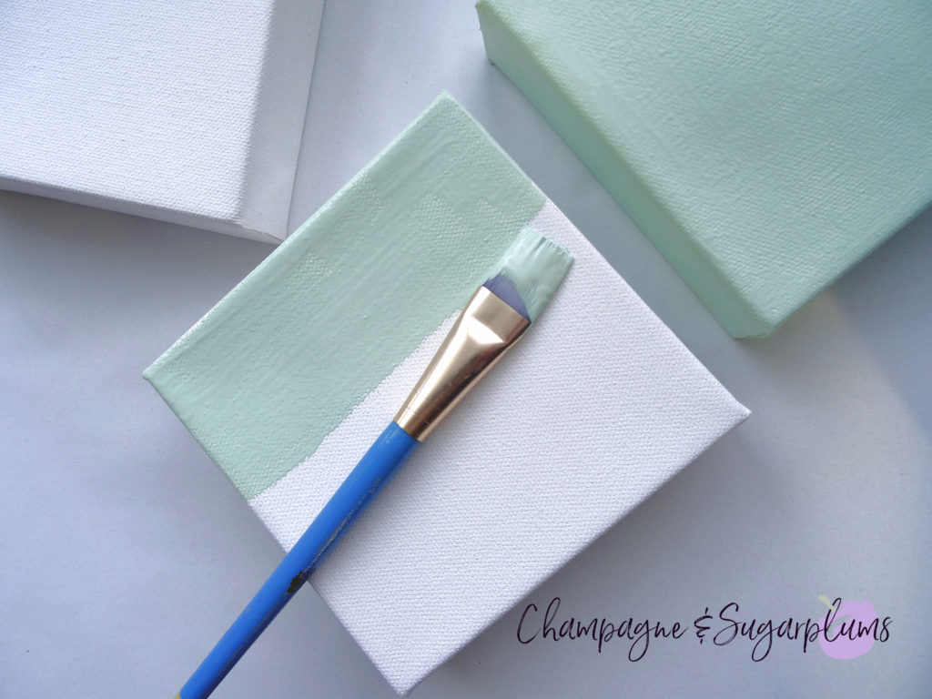 Painting three small canvases in mint by Champagne and Sugarplums