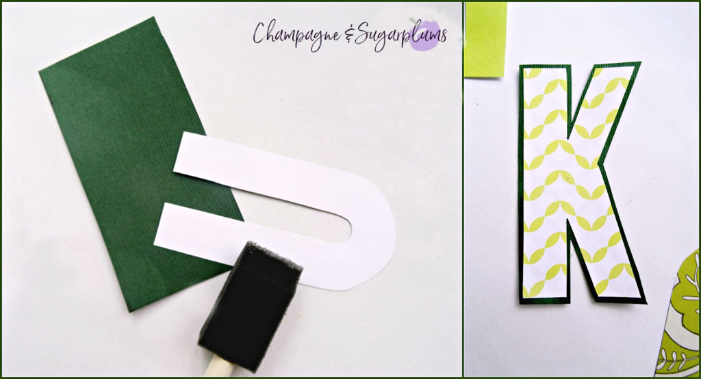 Cutting the letter K out of paper and gluing it to a dark background by Champagne and Sugarplums