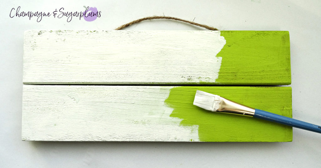 Painting over light green paint with white on a wood plank for a lucky signboard by Champagne and Sugarplums