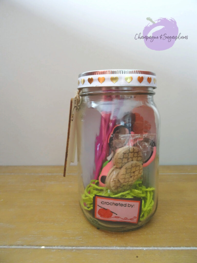 A completed yarn mason jar by Champagne and Sugarplums