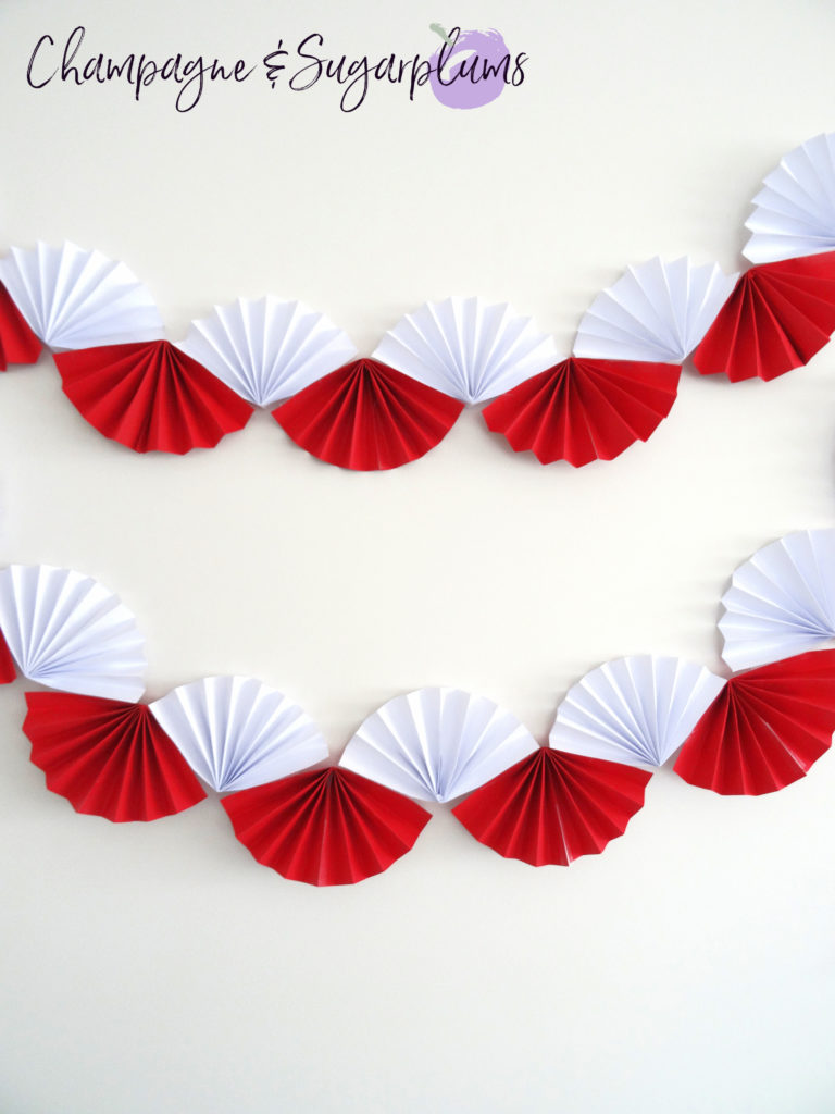 Canada Day Paper Garland on a white wall by Champagne and Sugarplums