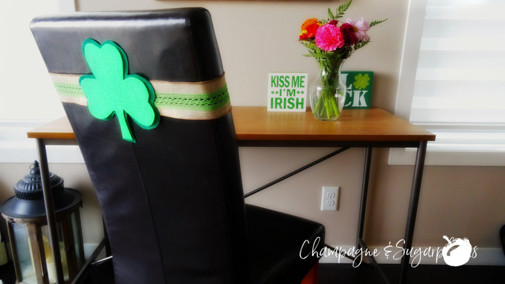 Clover chair sashes on a chair at the table by Champagne and Sugarplums