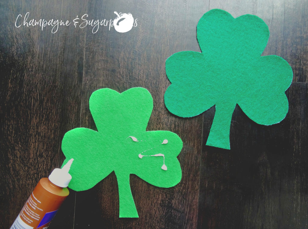 Gluing two felt clovers together by Champagne and Sugarplums