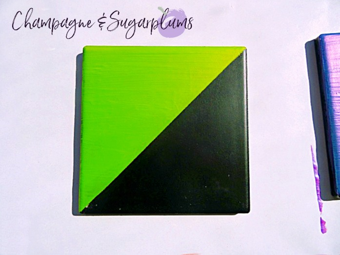 Coaster painted half green half black on a white background by Champagne and Sugarplums
