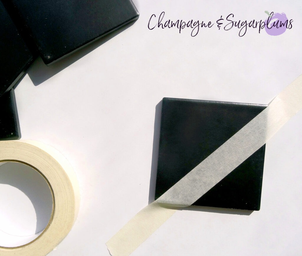Coaster being taped to divide in half on a white background by Champagne and Sugarplums
