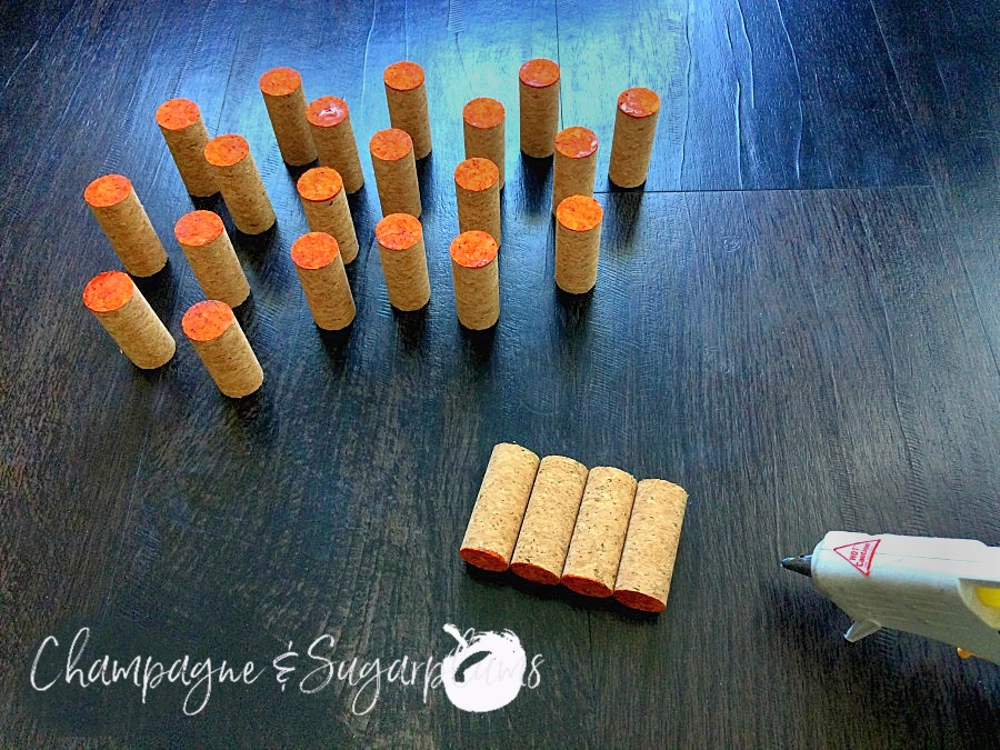 Corks being glued into rows by Champagne and Sugarplums