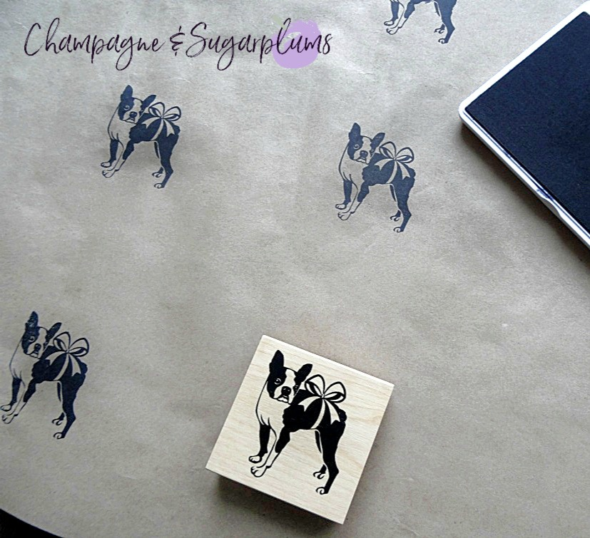 Butcher paper stamped with Boston terriers wrapped in a bow with an ink pad by Champagne and Sugarplums