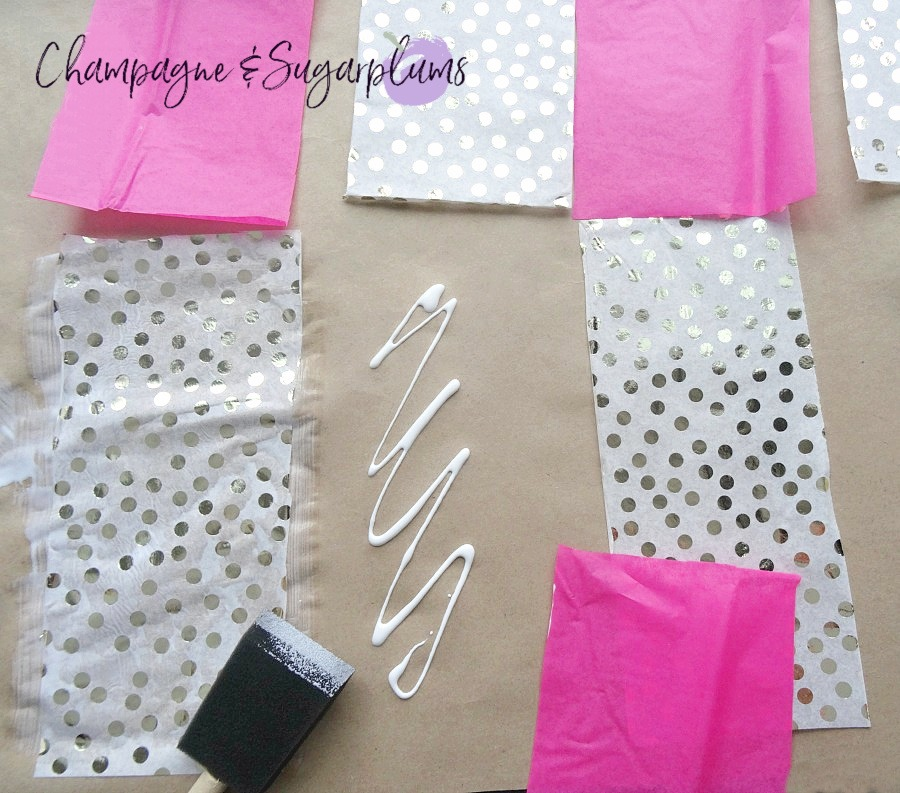 Pink and gold polka dot tissue paper glued in random patterns onto butcher paper by Champagne and Sugarplums