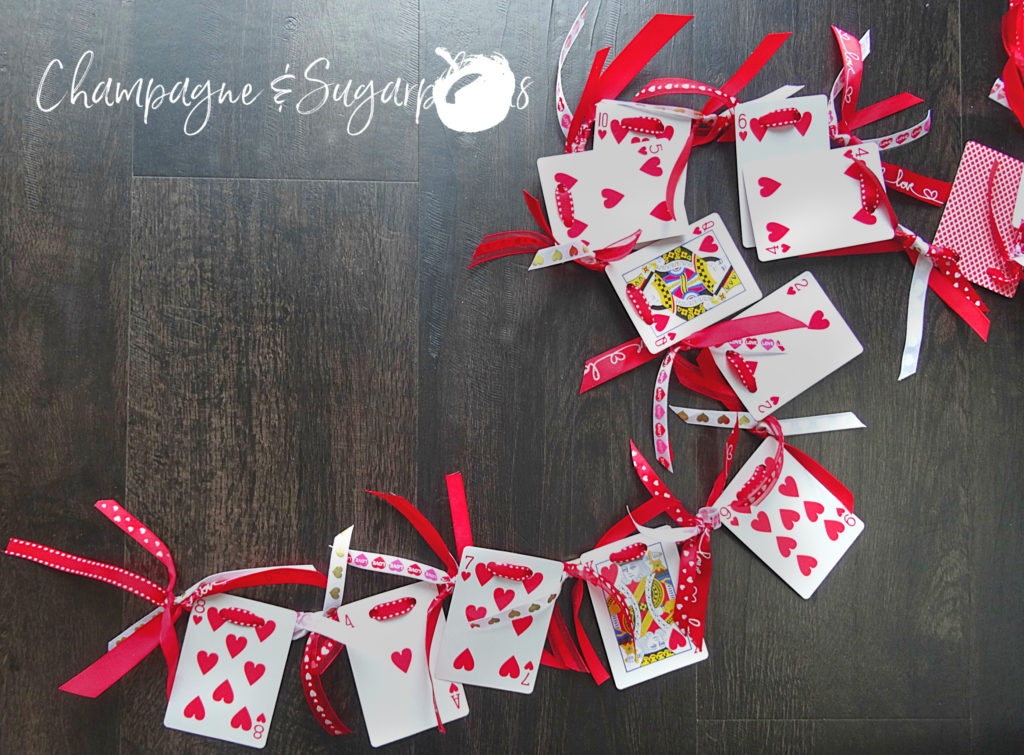 Heart cards garland on a dark background by Champagne and Sugarplums
