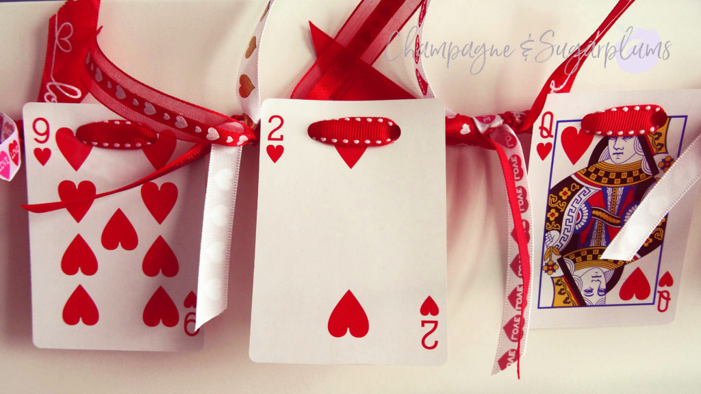 Heart cards garland on a white background by Champagne and Sugarplums