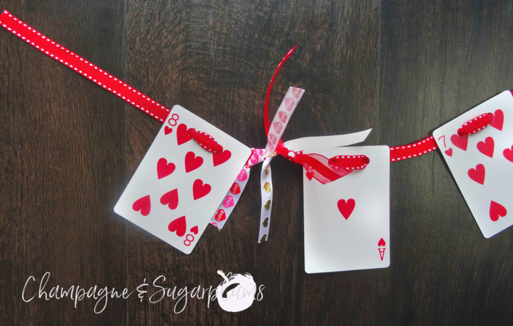 Heart cards garland having ribbons tied on for embellishment by Champagne and Sugarplums