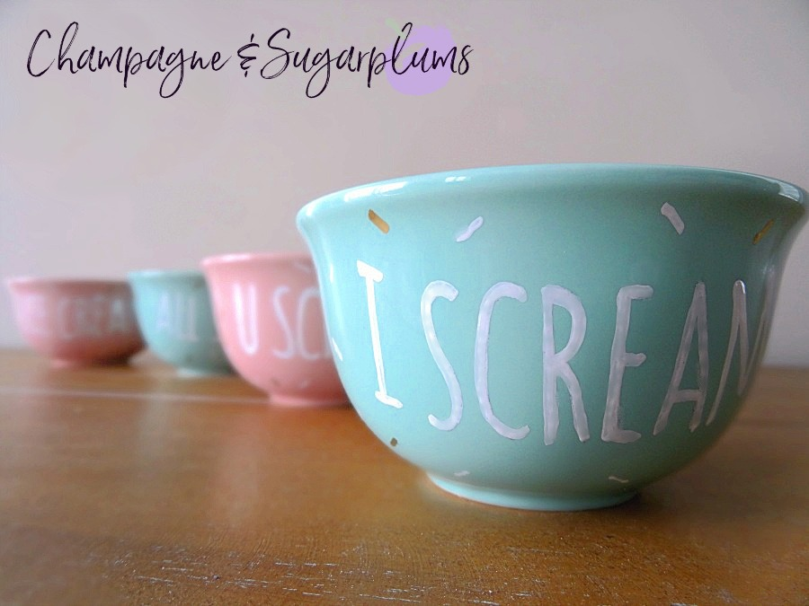 Four Ice cream bowls in a row on a table by Champagne and Sugarplums
