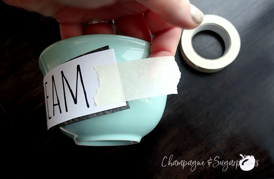 Taping graphite paper onto a bowl on a dark background by Champagne and Sugarplums