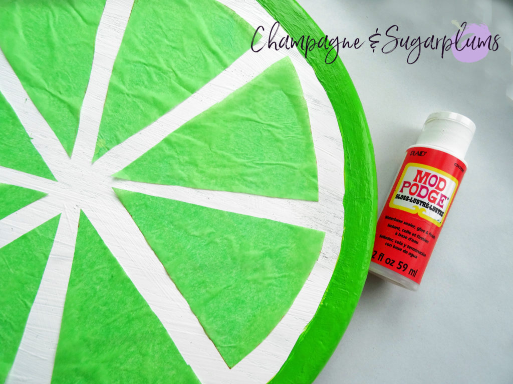 Lazy Susan with a pot of Mod Podge by Champagne and Sugarplums