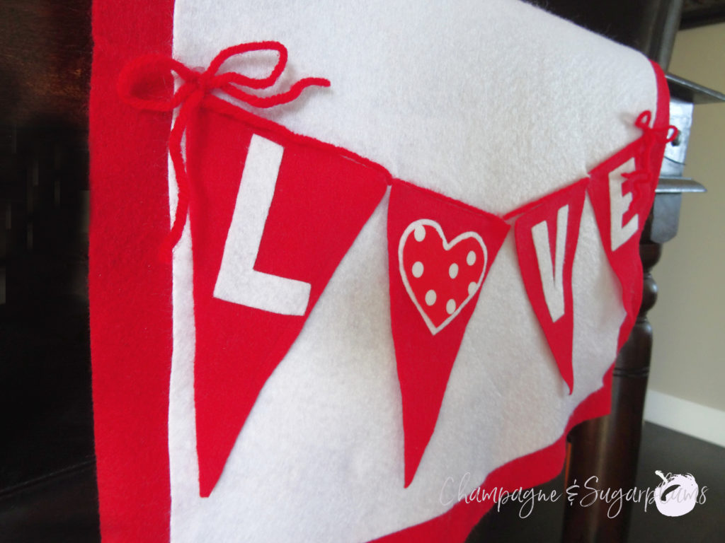 Love table runner on a dark table, close-up on an angle by Champagne and Sugarplums