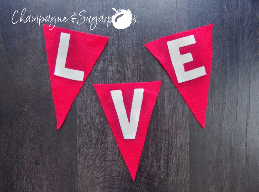White letters on red felt flags by Champagne and Sugarplums