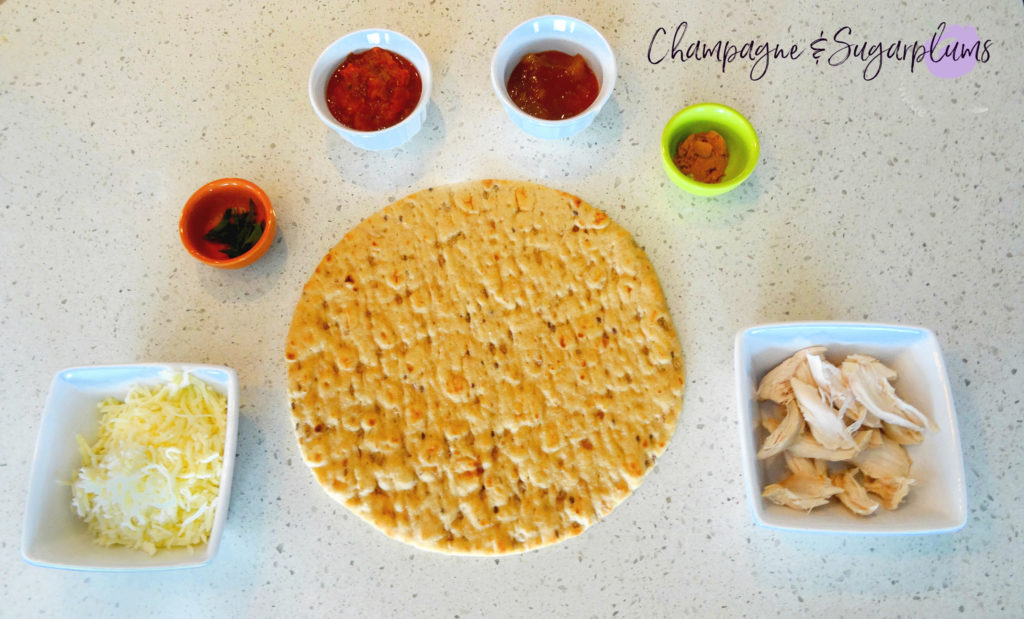 Ingredients to make pizza by Champagne and Sugarplums