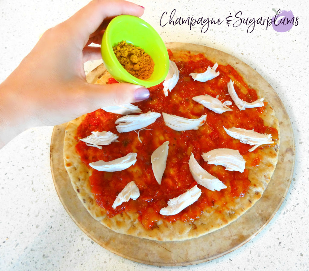 Adding curry powder to a pizza by Champagne and Sugarplums