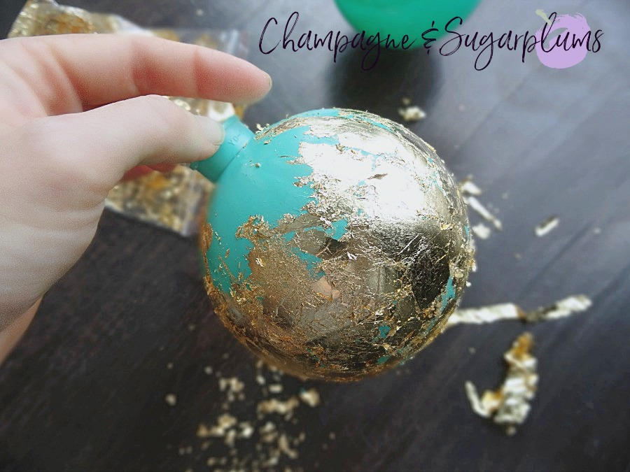 Gold gliding applied to teal ornament by Champagne and Sugarplums