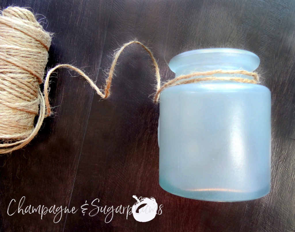 painted bottle embellished with twine on a dark wood background by Champagne and Sugarplums