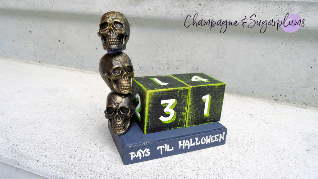 Halloween advent skull advent on a white concrete background by Champagne and Sugarplums