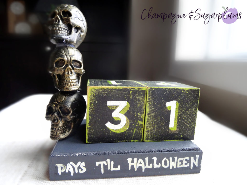 Halloween advent skull advent on a bench in front of a window by Champagne and Sugarplums
