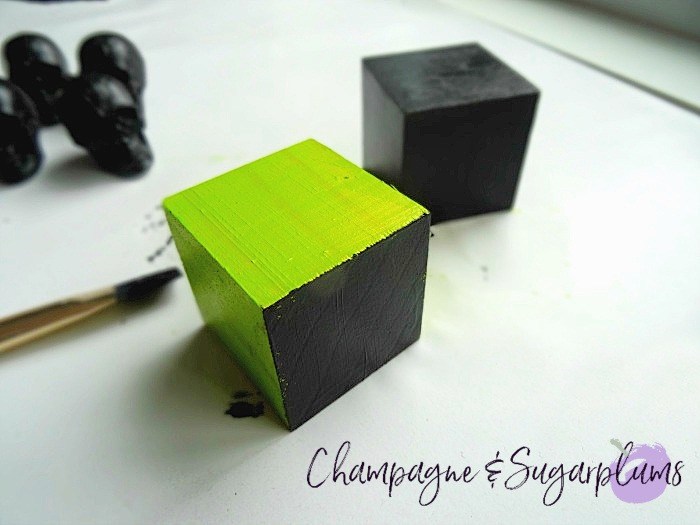 Painting black paint over green wood blocks by Champagne and Sugarplums