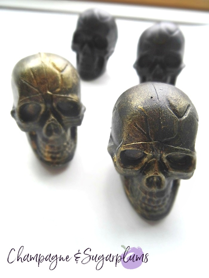 Dry-brush black skulls with gold paint by Champagne and Sugarplums