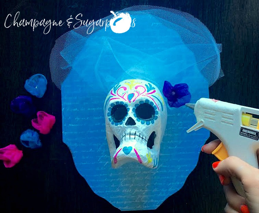 Sugar skulls being embellished with tulle and flowers by Champagne and Sugarplums