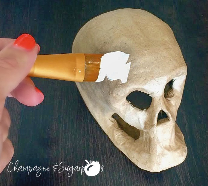 Painting a paper skull white by Champagne and Sugarplums
