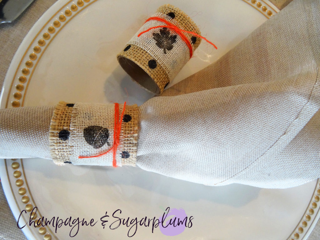 Thanksgiving napkin rings on a dinner plate by Champagne and Sugarplums
