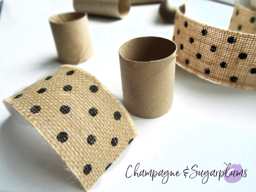 A cut toilet paper roll and with polka dot ribbon by Champagne and Sugarplums