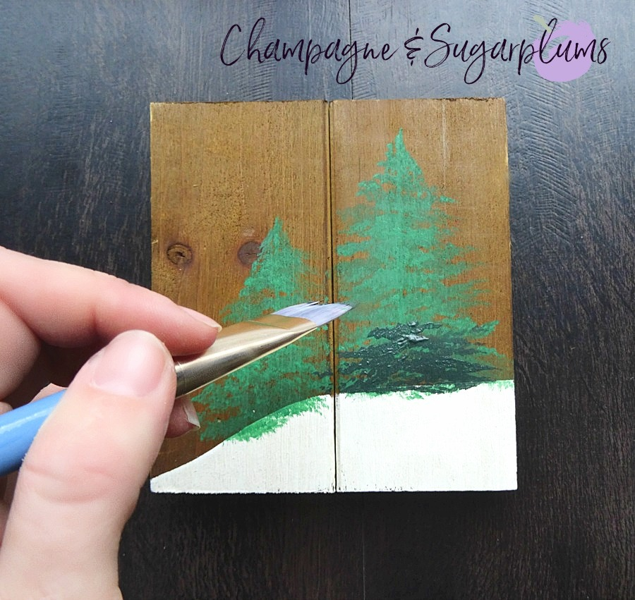 Painting dark green over light green trees by Champagne and Sugarplums