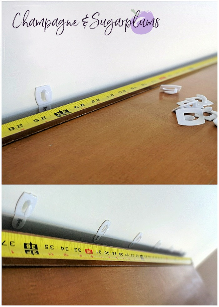 Measuring tape on a table with mini commend hooks by Champagne and Sugarplums