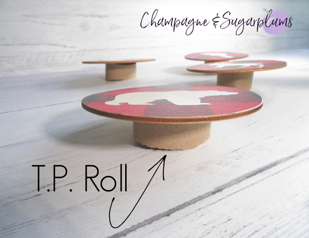 Balancing a wood coaster on top of a toilet paper roll by Champagne and Sugarplums