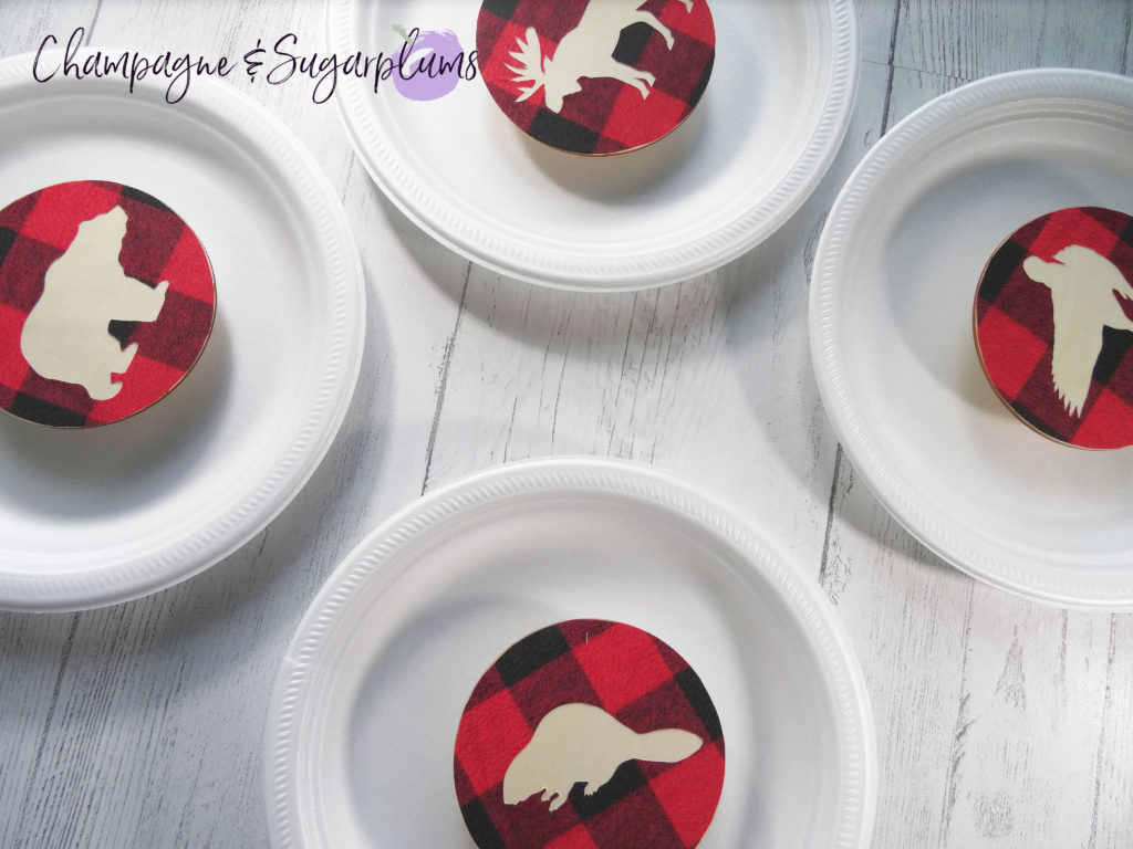 Wood coasters on paper plates by Champagne and Sugarplums