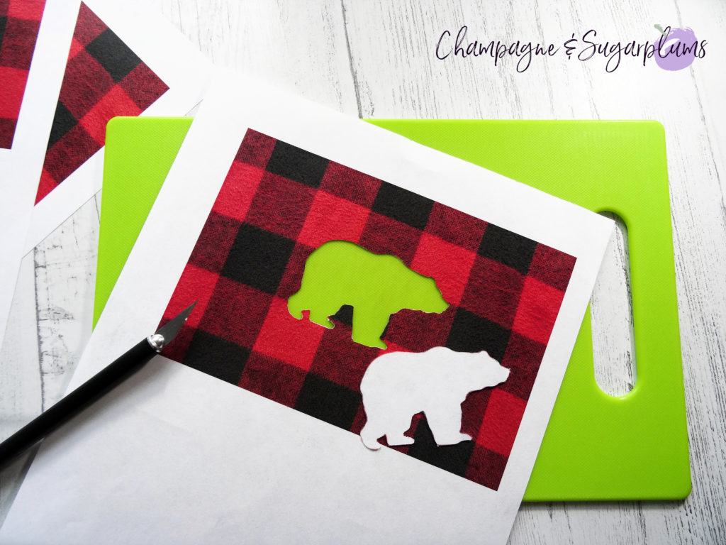 Cutting a bear shape out of paper with a craft knife by Champagne and Sugarplums