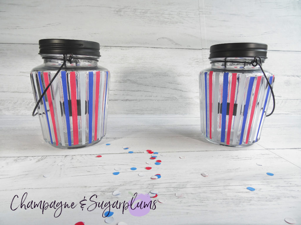 Fourth of July Celebration Candles by Champagne and Sugarplums