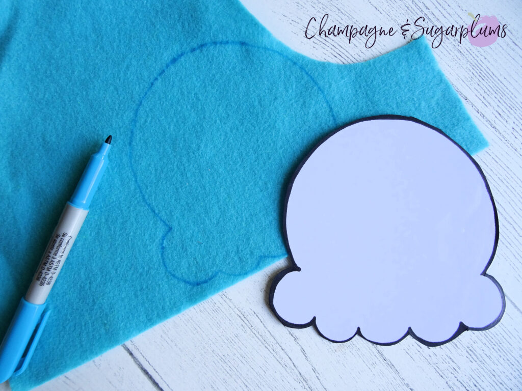 Tracing ice cream template onto blue felt by Champagne and Sugarplums