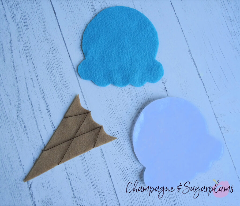 Sewing brown thread onto tan felt with blue and white ice cream felt by Champagne and Sugarplums