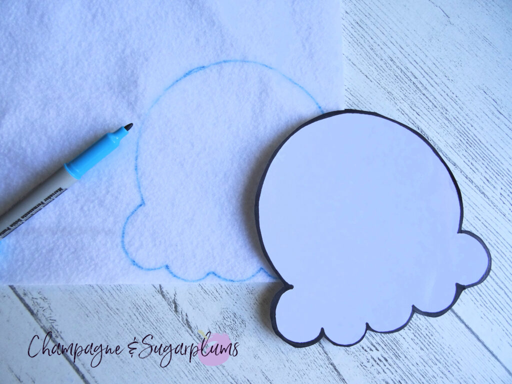 Tracing ice cream template onto white felt by Champagne and Sugarplums